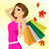 Young haughty woman with shopping bags Royalty Free Stock Images
