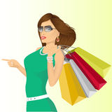 Young haughty woman with shopping bags Royalty Free Stock Photography