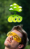 Young head looking at green eco sign Royalty Free Stock Photos
