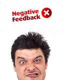 Young head looking at positive negative signs Royalty Free Stock Photography