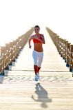 Young healhty woman jogging on the beach Royalty Free Stock Photos
