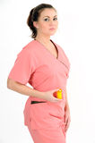 Young Healthcare professional - holding pills. Pretty young female healthcare professional in pink scrubs holding pills royalty free stock image