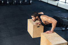Young healthy athlete doing push ups at the gym Royalty Free Stock Image
