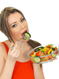 Young Healthy Attractive Woman Eating a Fresh Mixed Garden Salad Stock Photo
