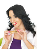 Young Healthy Attractive Woman Holding a Breakfast Cereal Bar Stock Photos