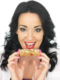 Young Healthy Attractive Woman Holding a Breakfast Cereal Bar Stock Images