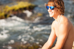 Young healthy beautiful men portrait on the beach Royalty Free Stock Photo