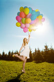 Young healthy beautiful pregnant woman with balloons outdoors. A Royalty Free Stock Images