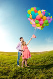 Young healthy beautiful pregnant woman with her husband and ball stock images
