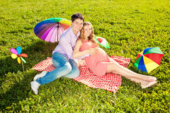 Young healthy beautiful pregnant woman with her husband and rain Stock Photography