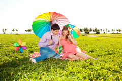 Young healthy beautiful pregnant woman with her husband and rain Royalty Free Stock Photos