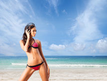 Young, healthy, beautiful and sexy woman on the beach Stock Images