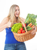 Young healthy beautiful woman with a basket full of fresh vegeta Stock Photos