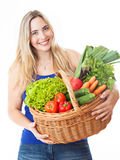 Young healthy beautiful woman with a basket full of fresh vegeta Stock Images