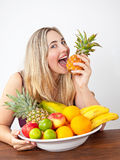 Young healthy beautiful woman with a bowl of fresh exotic fruit Royalty Free Stock Photography