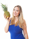 Young healthy beautiful woman with a pineapple Royalty Free Stock Images