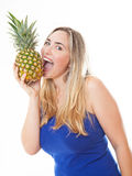 Young healthy beautiful woman with a pineapple Royalty Free Stock Photography
