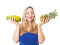 Young healthy beautiful woman with a pineapple and a papaya Stock Photos