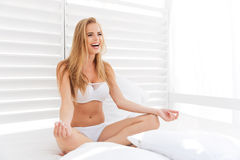 Free Young Healthy Beautiful Woman Sitting In Lotus Position In Bed Royalty Free Stock Photo - 77864845