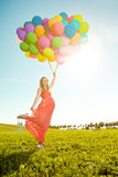 Young healthy beauty pregnant woman with balloons outdoors. A g stock photos