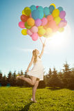 Young healthy beauty pregnant woman with balloons  outdoors. A g Stock Image