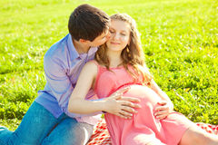 Young healthy beauty pregnant woman with her husband and balloon Stock Photography