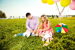 Young healthy beauty pregnant woman with her husband and balloon Royalty Free Stock Photography