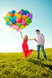 Young healthy beauty pregnant woman with her husband and balloon Royalty Free Stock Images