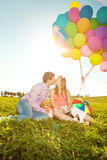Young healthy beauty pregnant woman with her husband and balloon Royalty Free Stock Photos