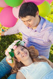 Young healthy beauty pregnant woman with her husband and balloon Stock Photo