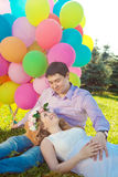 Young healthy beauty pregnant woman with her husband and balloon Royalty Free Stock Image