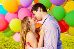 Young healthy beauty pregnant woman with her husband and balloon Stock Image
