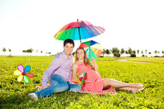 Young healthy beauty pregnant woman with her husband and rainbow Stock Photo