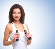 A young and healthy woman with a skipping rope Royalty Free Stock Photo
