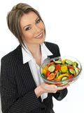 Young Healthy Business Woman Eating a Fresh Mixed Salad Stock Photos