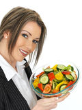 Young Healthy Business Woman Holding a Fresh Mixed Salad Stock Images