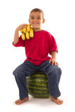 Young healthy child and fresh fruits Stock Image