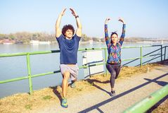 Young healthy couple doing stretching stock images