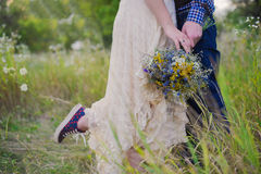 Young healthy couple fashionable girl in a wedding dress guy in a plaid shirt standing with a bouquet of bright flowers in hands, Stock Images