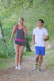 Young healthy couple running in forest Royalty Free Stock Images