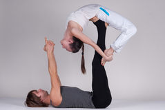 Young healthy couple in yoga position, Man and woman Royalty Free Stock Photos