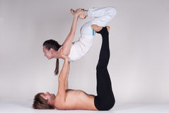 Young healthy couple in yoga position, Man and woman Stock Photos
