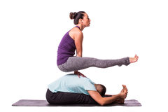Young healthy couple in yoga position. On white background Royalty Free Stock Photography