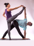 Young healthy couple in yoga position Stock Photo