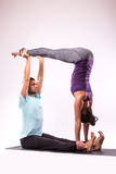 Young healthy couple in yoga position Stock Photography