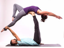 Young healthy couple in yoga position Royalty Free Stock Photography