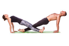 Young healthy couple in yoga position Stock Photos