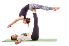 Young healthy couple in yoga position Royalty Free Stock Photo