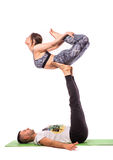 Young healthy couple in yoga position Stock Images