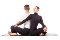 Young healthy couple in yoga position on white background Royalty Free Stock Photo